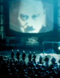 Picture of a large Telescreen taken from the 1984 film Nineteen Eighty-Four telescreen cropped screenshot